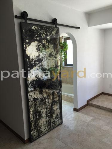 custom antique mirror barn door with blacken iron