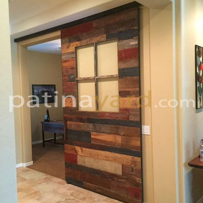 Barn door built of barn wood and using a box rail