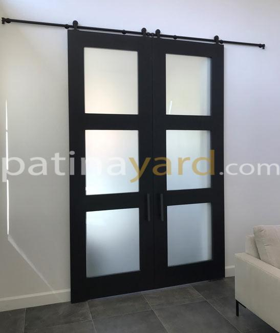 black shaker double barn doors with frosted glass panels