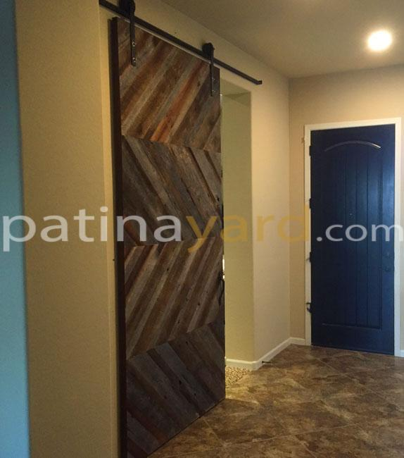 Custom chevron barn door and custom blacken iron h