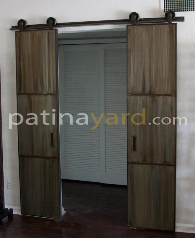 double warehouse style barn door with patina metal