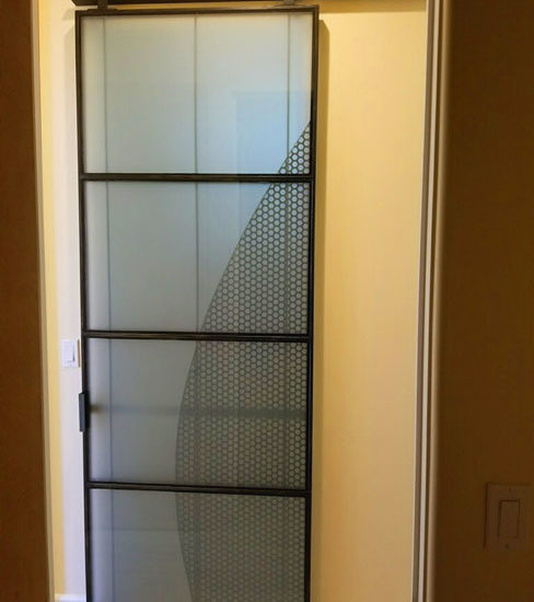 modern glass and metal barn door