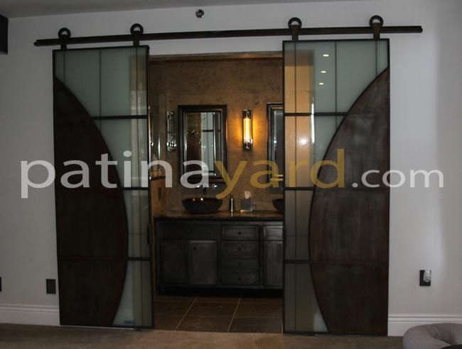 industrial artistic metal and glass barn door