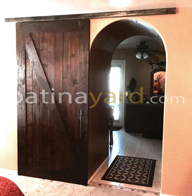 wood ranch style barn door stained and box rail track