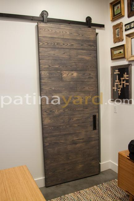 stained wood barn door and hardware