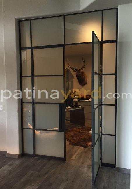 black iron steel doors with satin glass transoms and side lites