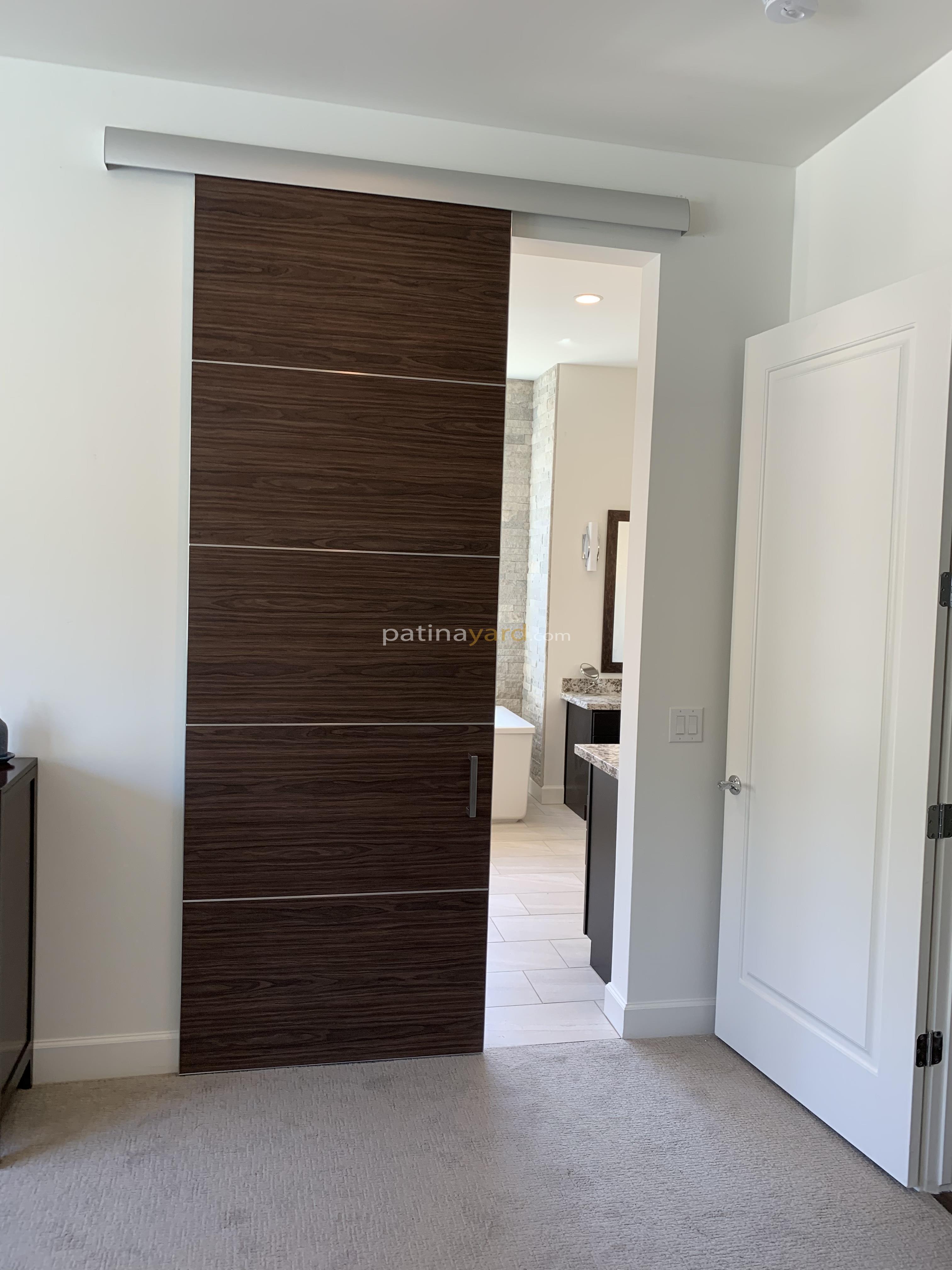 Bella laminate oak door with stainless seams
