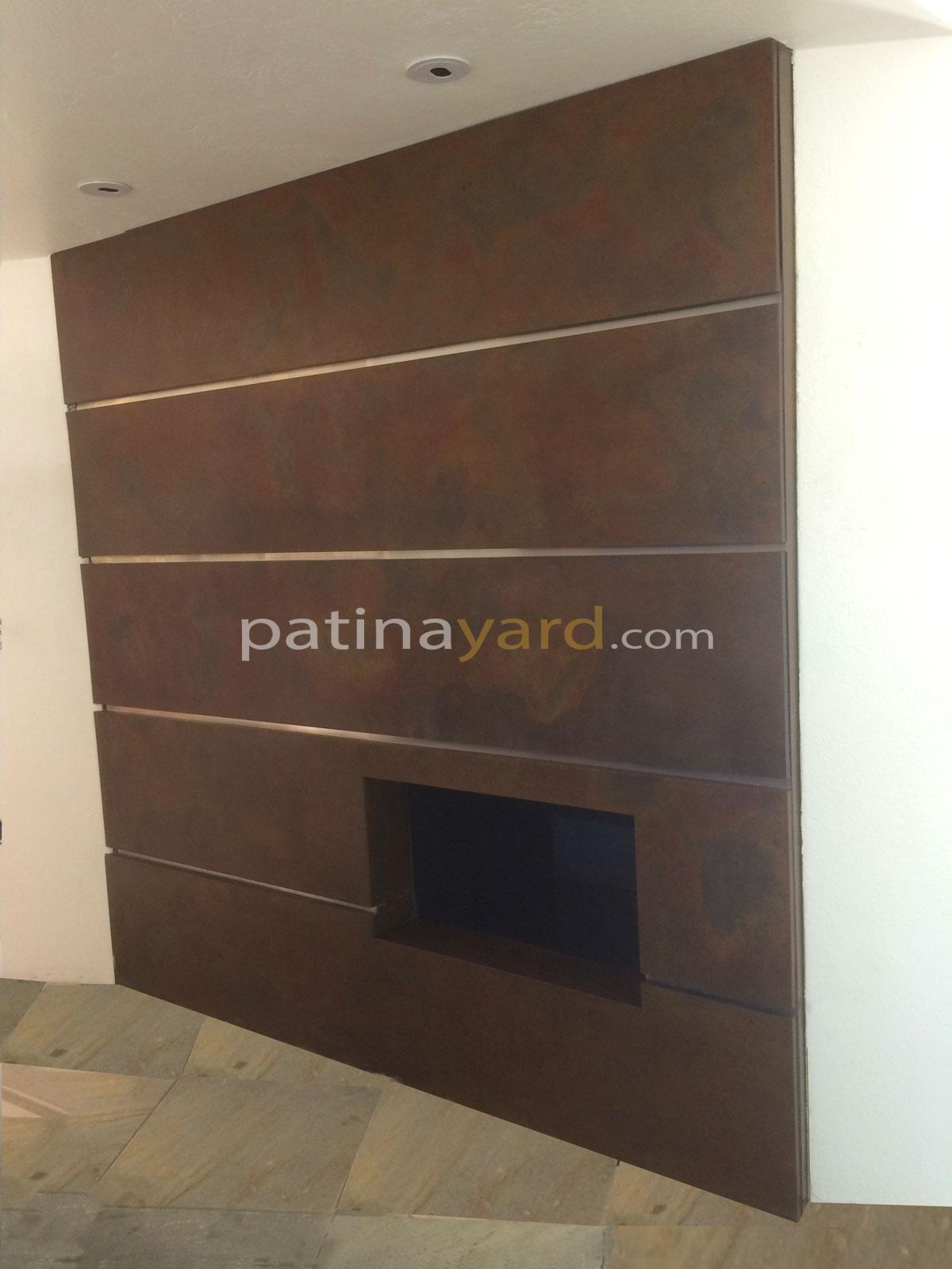 contemporary metal panels patinaed fireplace