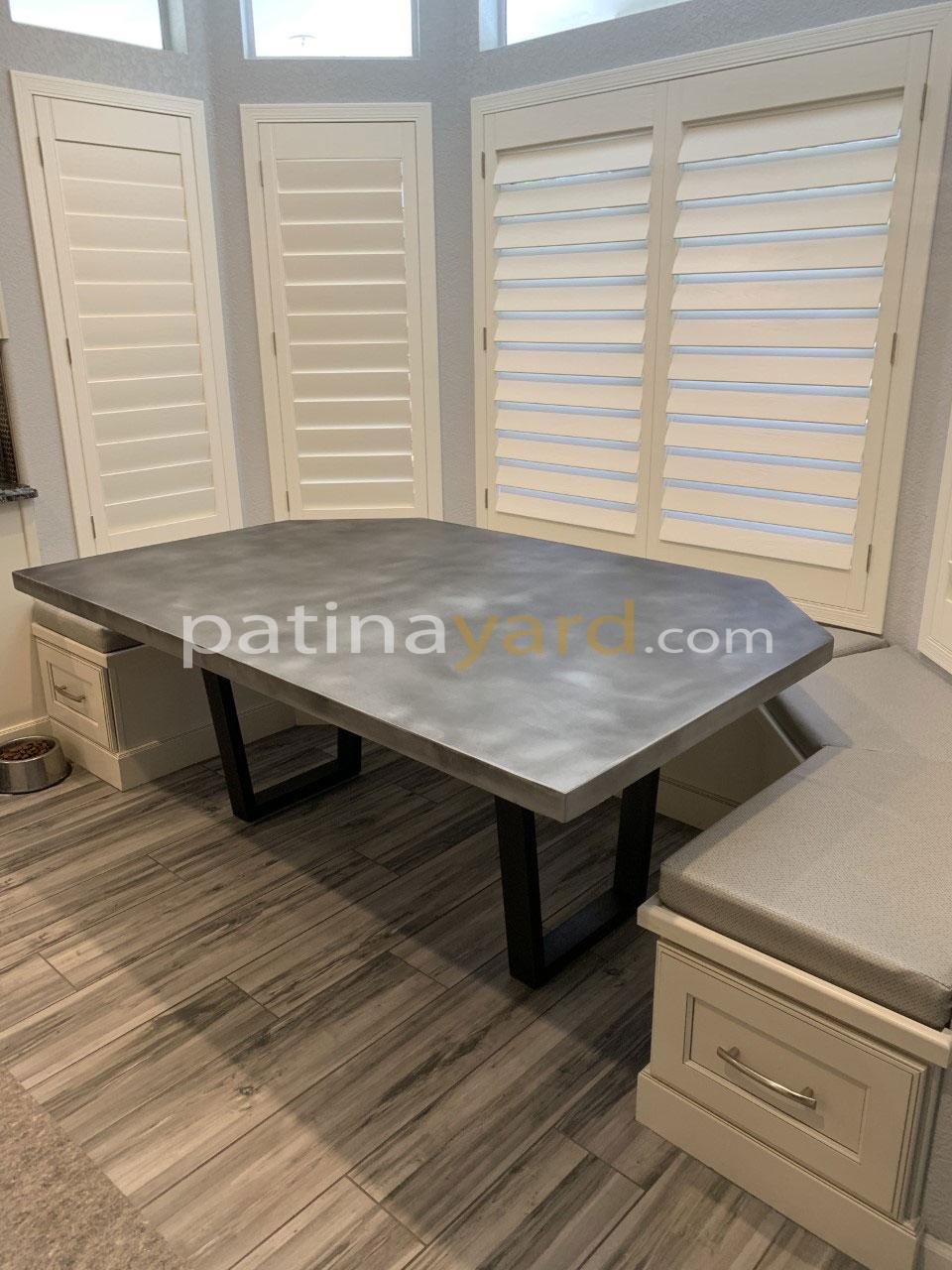zinc table with u shaped metal legs