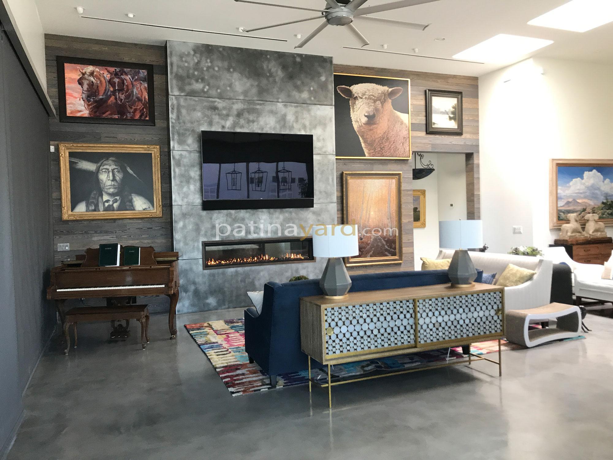 zinc metal fireplace surround and wood walls