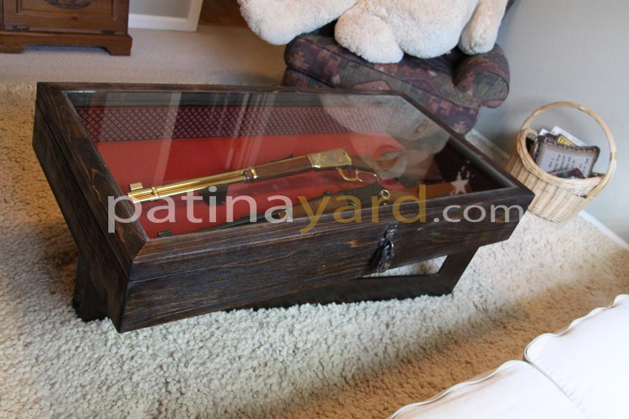gun encased coffee table
