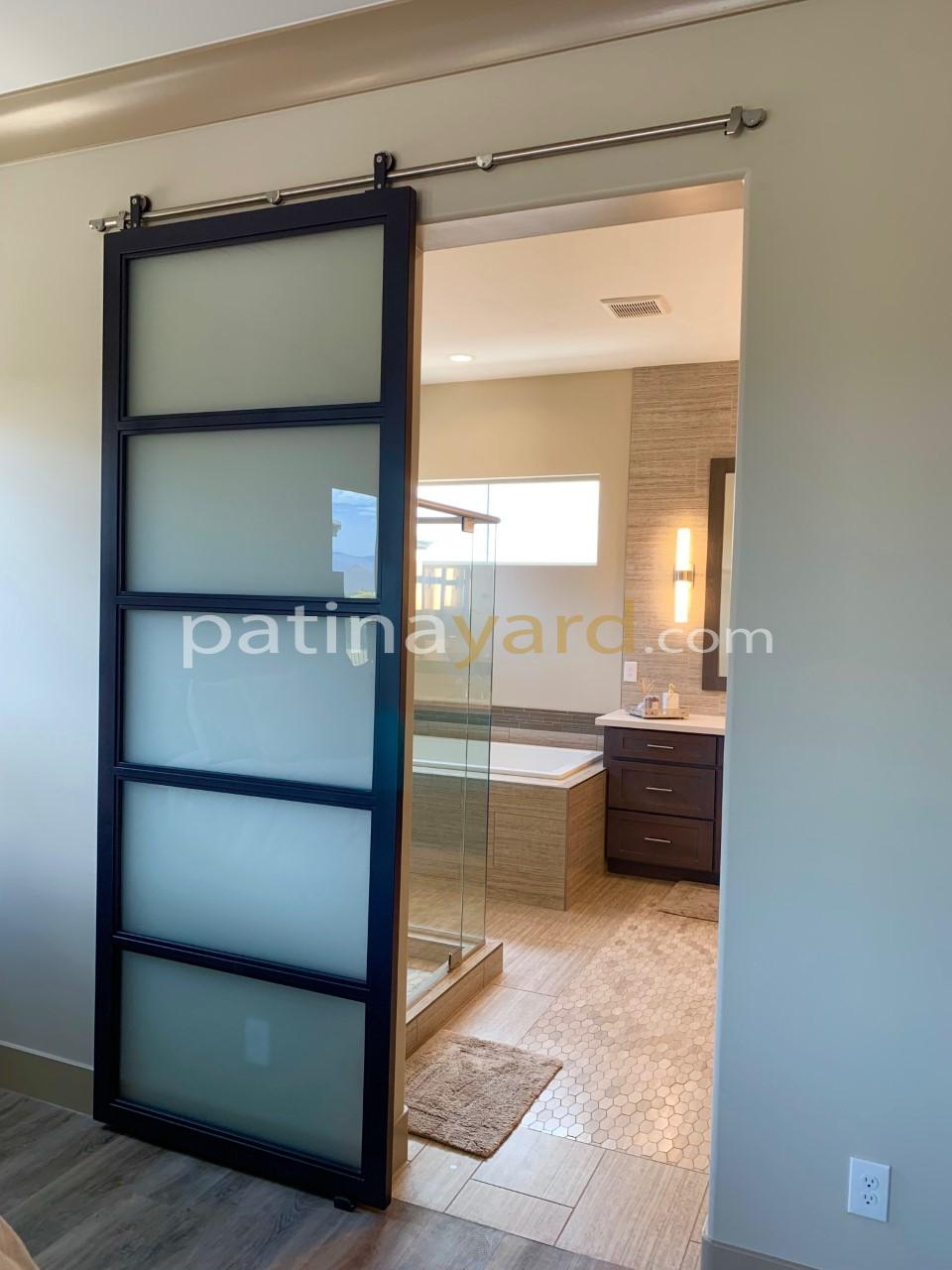 contemporary frosted glass and metal black barn door