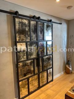 contemporary industrial double doors with random antique mirrors
